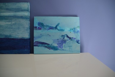 Movement and Clouds of White on Table with Pitch Blue Backdrop